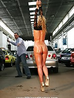 Pretty blonde suspended in a garage and whipped