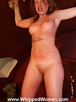 Domme whips pretty slave on pussy and tits