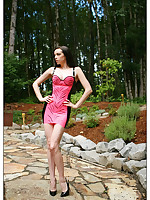 Emily Marilyn sexy brunette stripping out of latex in forest