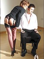 Domme in garters teases her slaveboy