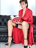 Domme in red robe demonstrates trampling on toys