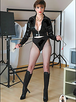 Fetish-clad Domme poses and teases