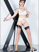 Domme in white panties and garter tramples a dildo