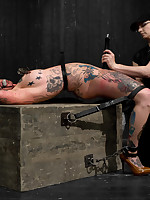 Blue eyed, large tits, tattooed dream girl Kathryn submits to bizarre leather mummification bondage, suspension, wicked intense orgasms, and pain.