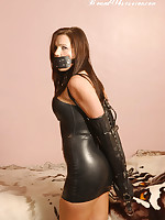 Busty impenetrable Donna is gagged and chained up wearing a not roundabout hawt taut black latex livery
