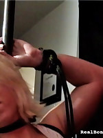 Gagged indulge suffers from smothering and enjoying a marital-device