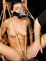 Brunette gagged and bound naked to a chair