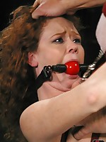 Redhead receives anal while bound and suspended