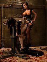 Gorgeous female slave trainer Nika Noir puts slave trainee to the test