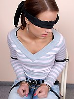 Smoking and drinking girl cuffed and tied on the chair