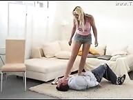 Brown headed mistress trampling on men chest