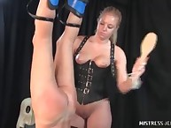 Blonde headmistress pumped slave's chocolate hole and spanked his bottom