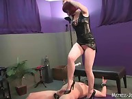 Hot mistress with strapon trampled him