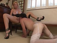 Blonde dominatrix in dress smothered sub by pussy
