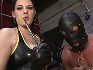 The dominant babe in latex dress tortured male's balls