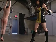 Dominatrix in latex dress spanked her bound boy