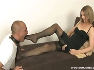 The pantyhosed dominatrix lets a slave to kiss her feet
