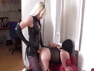 Hot blond in latex suit fucks her serf in the ass