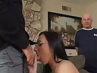 Wife in glasses engulfing a cock