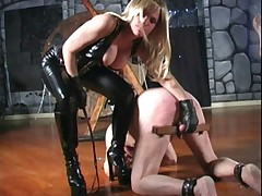 Golden-haired Dominatrix knows how to tread with slaves