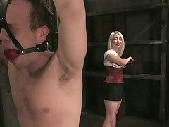 Hot upskirt mistress who likes fetish torturing a sub