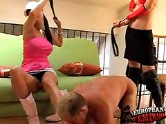 Hot young dommes spanking their elderly slave