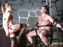 Latex domme spanking her slave really hard