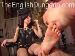 Slave's mouth is stuffed with domme's feet