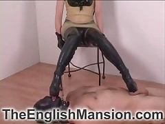 Domme in boots is trampling her male sub