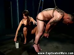 Perverted whore adores humiliating male slaves