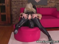 Mistress in leather disciplining male slave