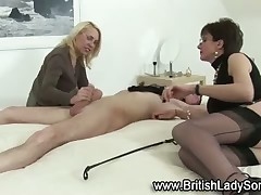 Mistresses in sexy nylons fucking