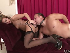 Domme is cleaning her ass with slave's tongue