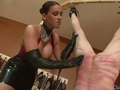 Dominatrix Megan spanked her slave with whip