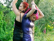 The latex slave was suspended to a tree