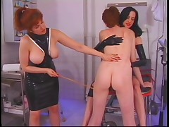 Two leather dominatrix whip redheaded slave on ass until she cries