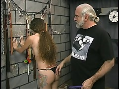 Young tattooed bdsm victim girl gets her pussy whipped by older slave master