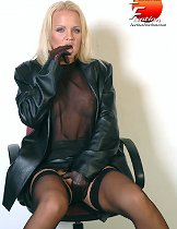 This sexy blonde plays rubs her pussy with leather covered fingers