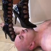 Slave suffering from mistress%u2019s feet on his face