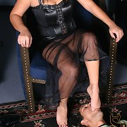 Michelle is sitting in her throne wearing a pair of fetish..