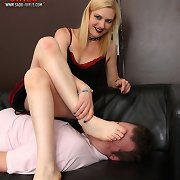 A blonde sits on malesub and humiliates him by feet