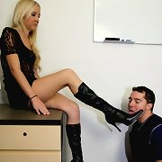 A submissive worker kissed boots