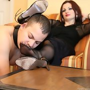 Submissive boy licked nyloned feet
