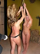 Two pretty blondes punished in cage