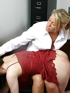 <!–-IMAGE_COUNT-–> of Teacher spanks her busty girl with wooden paddle
