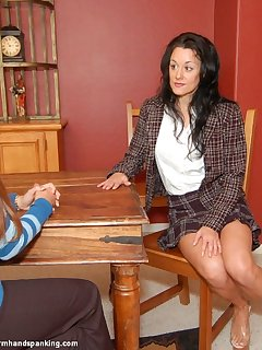 <!–-IMAGE_COUNT-–> of Georgia Schafer being spanked by Cindy Wallace