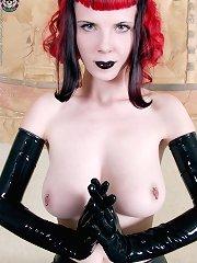 Gothic girl in black latex gloves