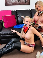Horny milf plays with some lovely big tits as she ties up this hot lesbian slut