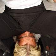 Blonde mistress sat on manslave