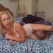 Sexy blonde sits on old slave